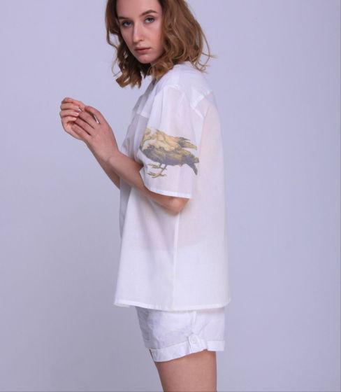 Женская блуза с ввороной на рукаве