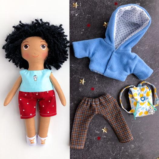 Игровая кукла - мальчик с одеждой